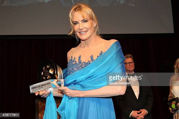 Daryl Hannah with award attends the 5th Filmball Vienna at City Hall on March 14 2014 in Vienna Austria