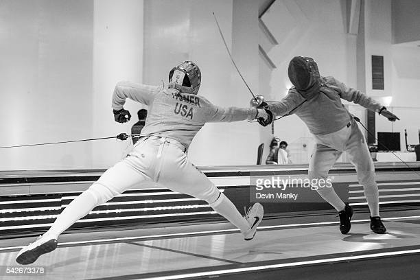Daryl Homer of the United States lunges to attack Abraham Rodriguez of Venezuela during Men's Sabre competition at the PanAmerican Fencing...