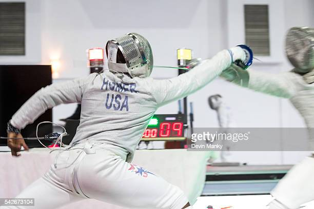 Daryl Homer of the USA attacks Abraham Rodriguez of Venezuela during the Men's Sabre competition at the PanAmerican Fencing Championships on June 23...