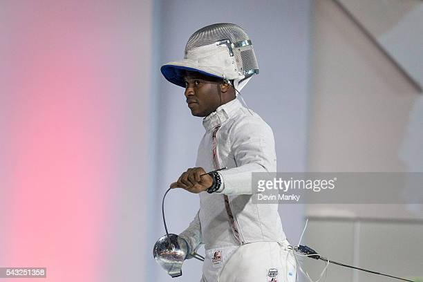 Daryl Homer of the USA straightens his sabre before beginning a bout in the gold medal match against Argentina during the Team Men's Sabre event The...