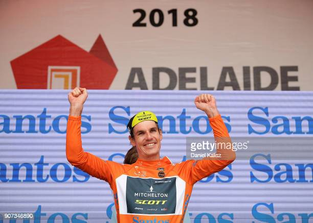 Daryl Impey of South Africa and MitcheltonScott celebrates on the podium after taking the leaders ochre jersey during stage five of the 2018 Tour...