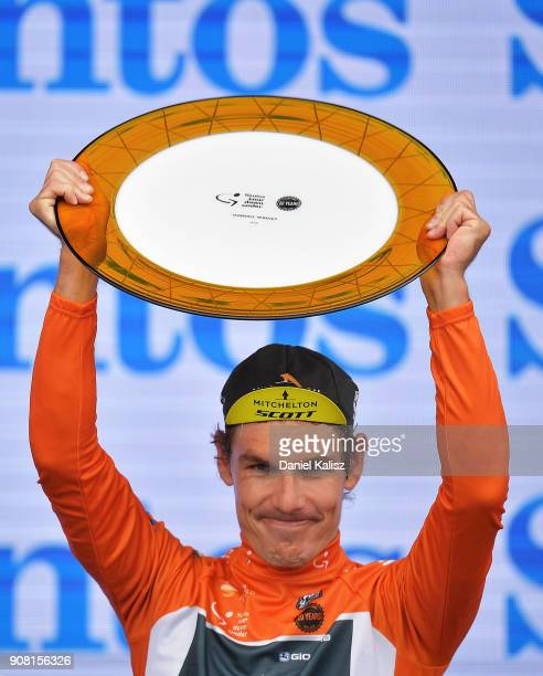 Daryl Impey of South Africa and Mitchelton-Scott celebrates on the podium after winning the ochre jersey and the 2018 Tour Down Under during stage...