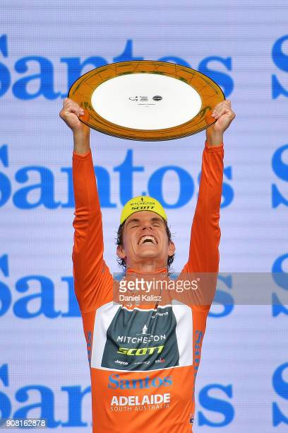 Daryl Impey of South Africa and MitcheltonScott celebrates on the podium after winning the ochre jersey and the 2018 Tour Down Under during stage six...