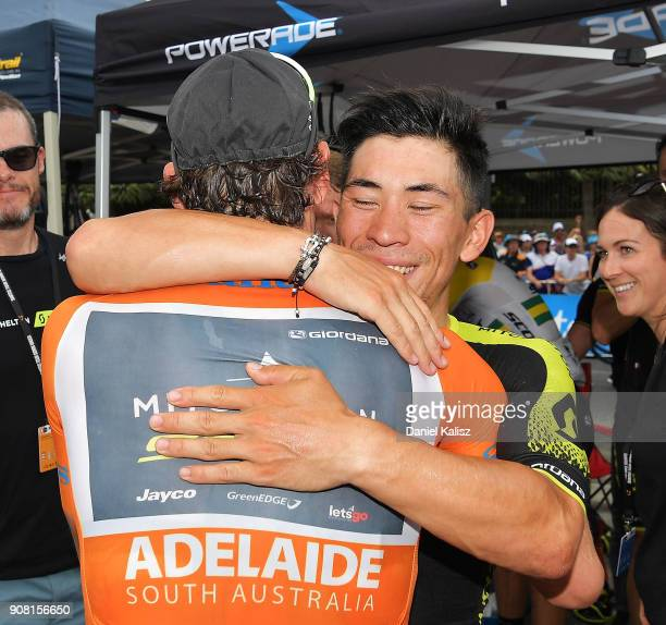 Daryl Impey of South Africa and MitcheltonScott celebrates with Caleb Ewan of Australia and MitcheltonScott after winning the ochre jersey during...