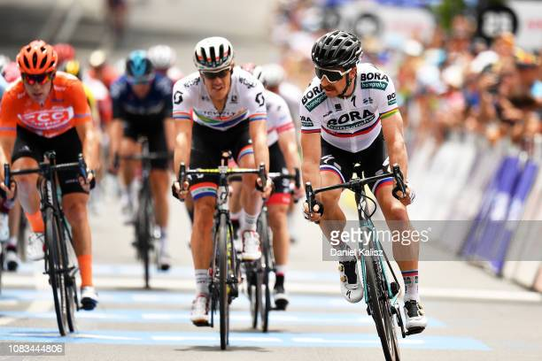 Daryl Impey of South Africa and Team Mitchelton-Scott and Peter Sagan of Slovakia and Team Bora-Hansgrohe cross the finish line during stage three of...