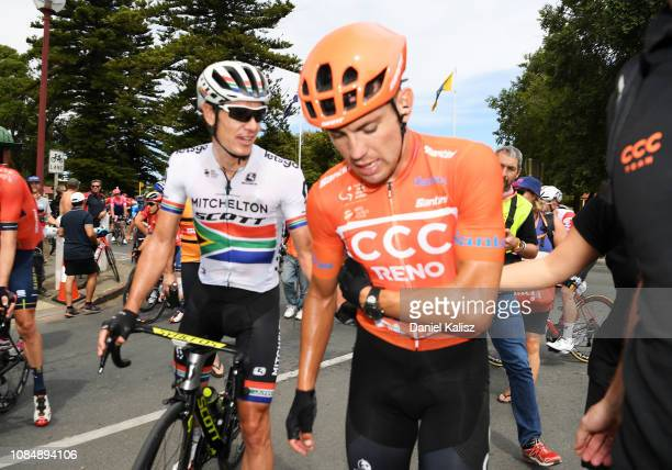Daryl Impey of South Africa and Team Mitchelton-Scott speaks with Patrick Bevin of New Zealand and CCC Team Orange Leader Jersey / Injury / Crash /...