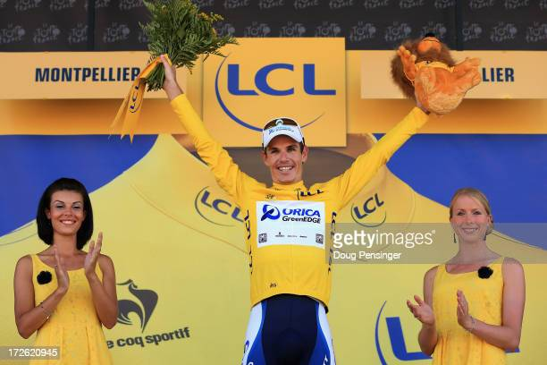 Daryl Impey of South Africa riding for Orica GreenEDGE takes the podium after earning the overall race leader's yelllow jersey in stage six of the...