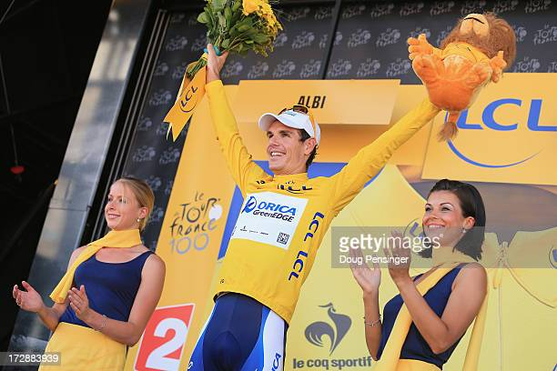 Daryl Impey of South Africa riding for OricaGreenEDGE takes the podium after defending the overall race leader's yellow jersey in stage seven of the...