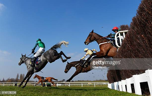 Daryl Jacob on Bristol De Mai clears a jump ahead of Ruby Walsh on Black Hercules in the JLT Novices' Chase on day three St Patrick's Thursday of the...