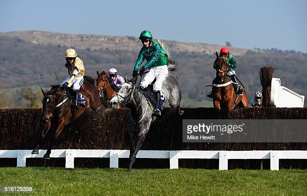 Daryl Jacob on Bristol De Mai clears a jump ahead of Ruby Walsh on Black Hercules and Nico de Boinville on L'Ami Serge in the JLT Novices' Chase on...