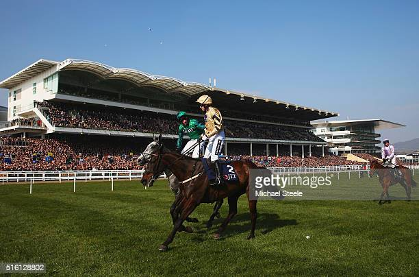 Daryl Jacob on Bristol De Mai congratulates winner Ruby Walsh after riding Black Hercules to victory in the JLT Novices' Chase on day three St...