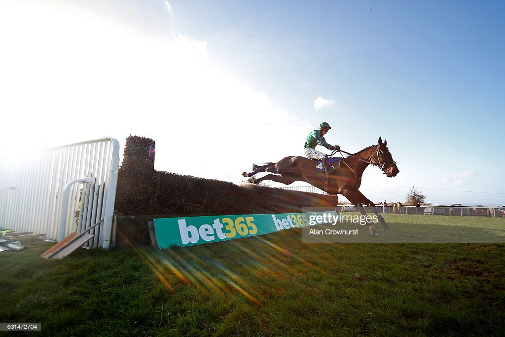 Daryl Jacob riding Calett Mad clear the last to win The Bathwick Tyres Handicap Steeple Chase at Taunton Racecourse on January 11, 2017 in Taunton, England.