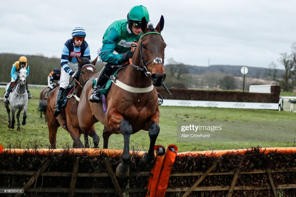 Daryl Jacob riding Delire D'Estruval on their way to winning The Follow Us On Twitter Novices' Hurdle Race at Towcester racecourse on February 14, 2018 in Towcester, England.
