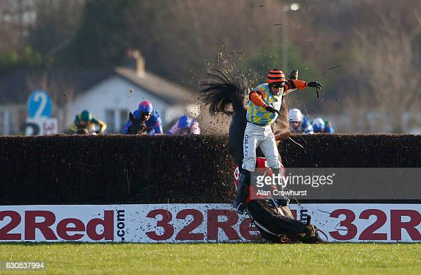 Daryl Jacob riding Might Bite fall at the last when clear in The 32Red Kauto Star Novices' Steeple Chase at Kempton Park on December 26 2016 in...