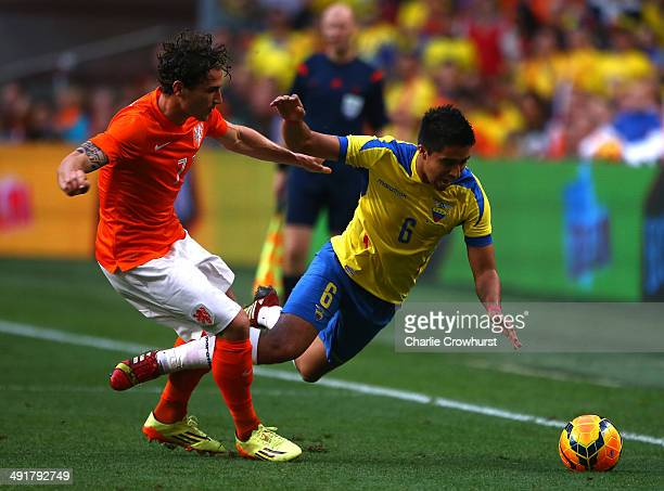 Daryl Jammaat of Holland puts a tough tackle in on Ecuador's Cristhian Noboa during the International Friendly match between The Netherlands and...
