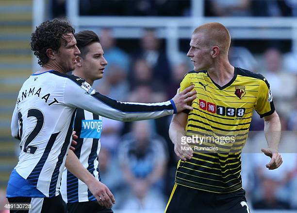 Daryl JanMaat and Florian Thauvin of Newcastle push Ben Watson of Watford from the pitch as he takes his time being substituted during the Barclays...