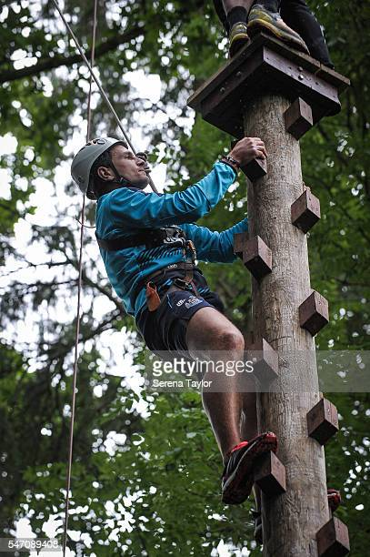 Daryl Janmaat climbs up the pole during the team building activity during the Newcastle United Training Camp at Carton House on July 12 in Kildare...