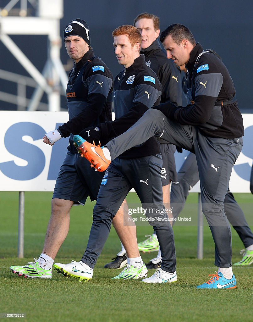 Daryl Janmaat (L), Jack Colback (C) and Steven Taylor (R) of Newcastle United during a training session at The Newcastle United Training Centre on December 19, 2014 in Newcastle upon Tyne, England.