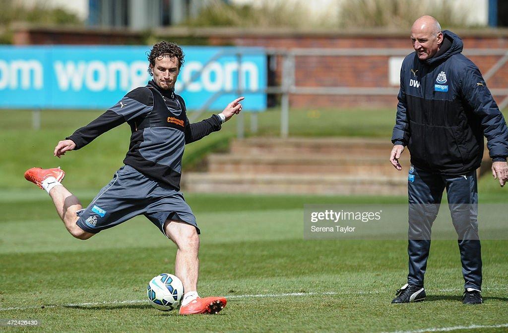 Daryl Janmaat Kicks The Ball Whilst Coach Dave Watson