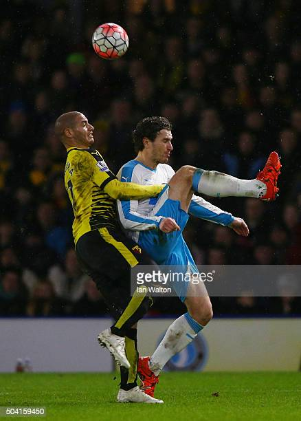 Daryl Janmaat of Newcastle United and Adlene Guedioura of Watford compete for the ball during the Emirates FA Cup Third Round match between Watford...