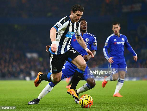 Daryl Janmaat of Newcastle United and Baba Rahman of Chelsea compete for the ball during the Barclays Premier League match between Chelsea and...