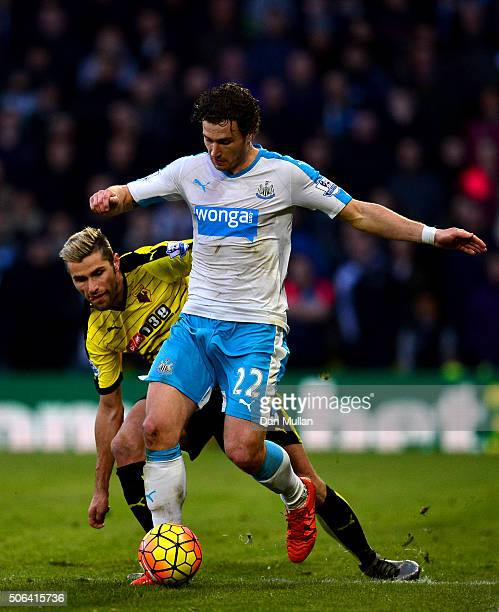 Daryl Janmaat of Newcastle United and Valon Berami of Watford compete for the ball during the Barclays Premier League match between Watford and...