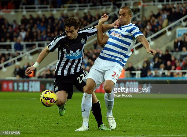 Daryl Janmaat of Newcastle United challenged by Bobby Zamora of Queeens Park Rangers during the Barclays Premier League football match between...