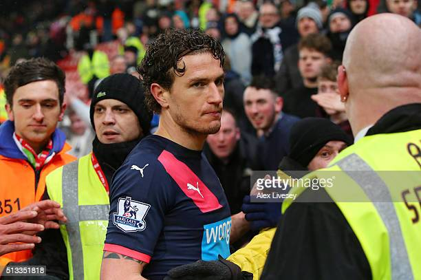 Daryl Janmaat of Newcastle United is confronted by unhappy Newcastle fans after the Barclays Premier League match between Stoke City and Newcastle...