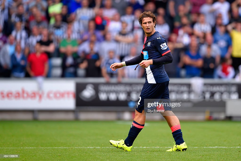 Daryl Janmaat of Newcastle United walks off the pitch after receiving a red card during the Barclays Premier League match between Swansea City and Newcastle United at Liberty Stadium on August 15, 2015 in Swansea, United Kingdom.