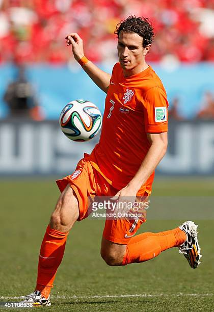 Daryl Janmaat of the Netherlands controls the ball during the 2014 FIFA World Cup Brazil Group B match between the Netherlands and Chile at Arena de...