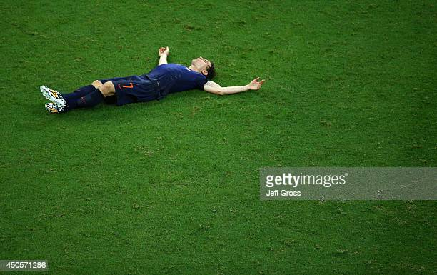 Daryl Janmaat of the Netherlands lies on the field at the end of the match during the 2014 FIFA World Cup Brazil Group B match between Spain and...