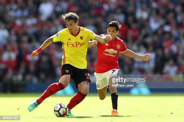 Daryl Janmaat of Watford and Alexis Sanchez of Manchester United battle for possession during the Premier League match between Manchester United and...