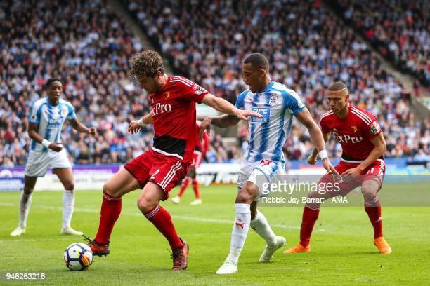 Daryl Janmaat of Watford and Rajiv Van La Parra of Huddersfield Town during the Premier League match between Huddersfield Town and Watford at John...