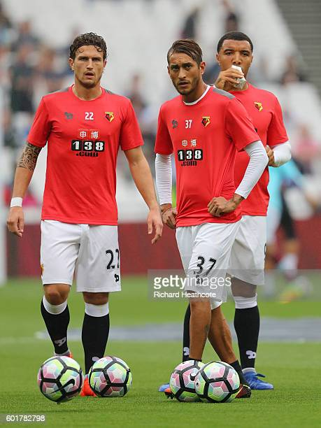 Daryl Janmaat of Watford and Roberto Pereya of Watford warm up prior to kick off during the Premier League match between West Ham United and Watford...