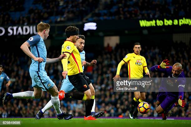 Daryl Janmaat of Watford attempts to clear while Heurelho Gomes of Watford attempts to save during the Premier League match between Manchester City...
