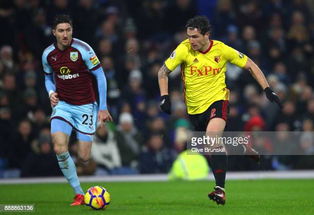 Daryl Janmaat of Watford attempts to get away Stephen Ward of Burnley during the Premier League match between Burnley and Watford at Turf Moor on...