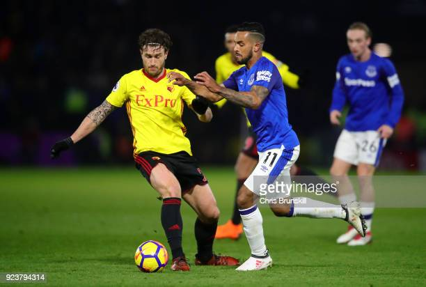Daryl Janmaat of Watford battles for possesion with Theo Walcott of Everton during the Premier League match between Watford and Everton at Vicarage...