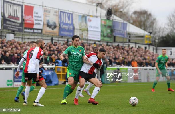 Daryl Janmaat of Watford battles for possession with Toby Edser of Woking during the FA Cup Third Round match between Woking and Watford at Kingfield...