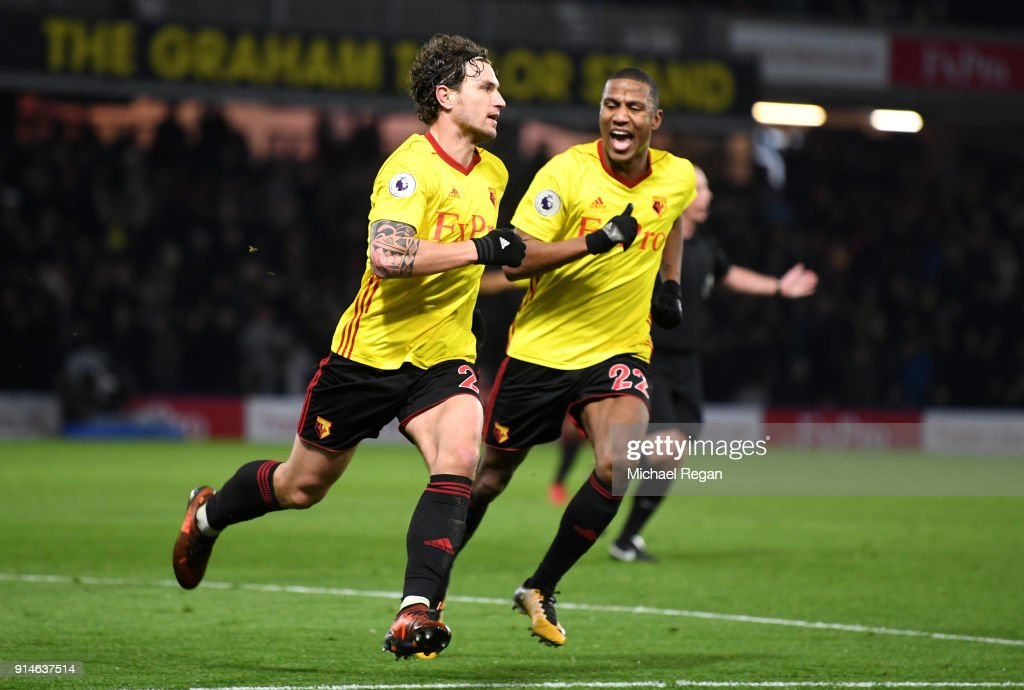 Daryl Janmaat of Watford celebrates scoring the 2nd Watford goal with Marvin Zeegelaar of Watford during the Premier League match between Watford and Chelsea at Vicarage Road on February 5, 2018 in Watford, England.