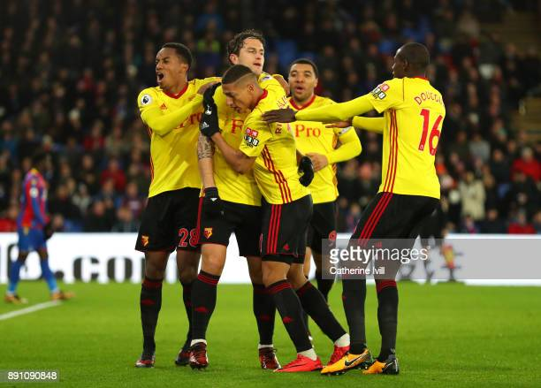 Daryl Janmaat of Watford celebrates with his teammates after scoring his sides first goal during the Premier League match between Crystal Palace and...