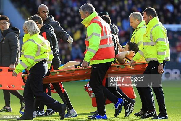 Daryl Janmaat of Watford is carried off on a stretcher after picking up an injury during the Premier League match between Watford and Crystal Palace...