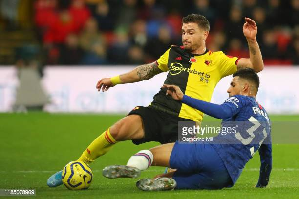 Daryl Janmaat of Watford is challenged by Emerson Palmieri of Chelsea during the Premier League match between Watford FC and Chelsea FC at Vicarage...