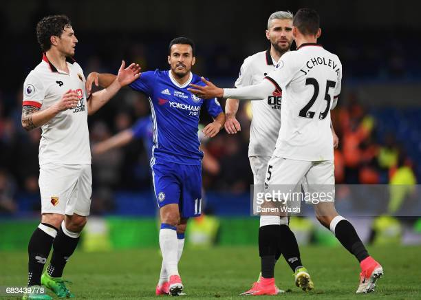Daryl Janmaat of Watford Jose Holebas of Watford clash with Pedro of Chelsea during the Premier League match between Chelsea and Watford at Stamford...