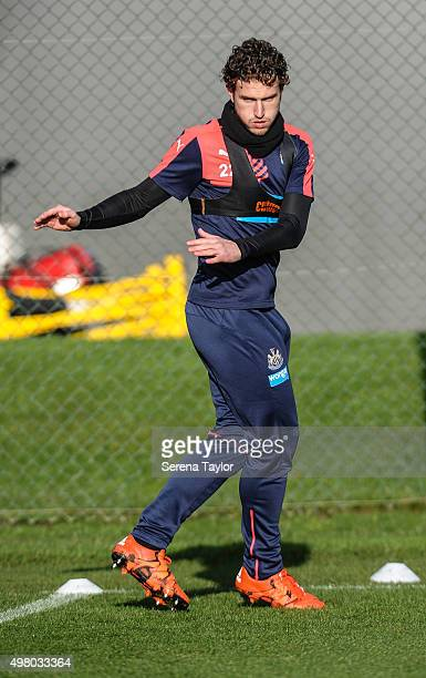 Daryl Janmaat warms up on the pitch during the Newcastle United Training session at The Newcastle United Training Centre on November 20 in Newcastle...
