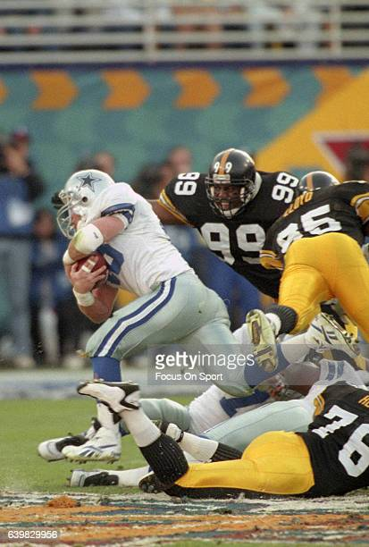 Daryl Johnston of the Dallas Cowboys carries the ball against the Pittsburgh Steelers during Super Bowl XXX on January 28 1996 at Sun Devil Stadium...