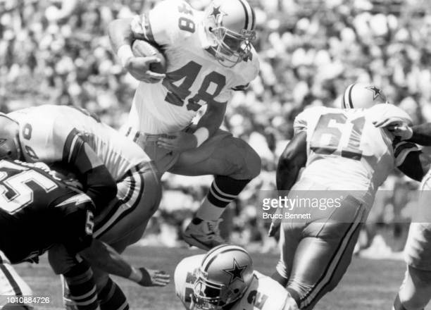 Daryl Johnston of the Dallas Cowboys runs with the ball during an NFL game against the San Diego Chargers circa 1990 at Jack Murphy Stadium in San...