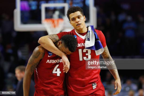 Daryl Macon and Dustin Thomas of the Arkansas Razorbacks react after being defeated by the North Carolina Tar Heels 7265 in the second round of the...