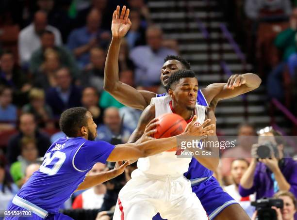 Daryl Macon of the Arkansas Razorbacks drives against Michael Nzei and Madison Jones of the Seton Hall Pirates in the second half in the first round...