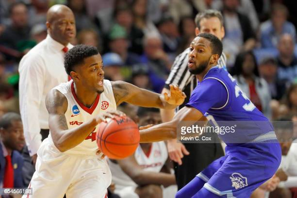 Daryl Macon of the Arkansas Razorbacks drives on Madison Jones of the Seton Hall Pirates in the second half in the first round of the 2017 NCAA Men's...
