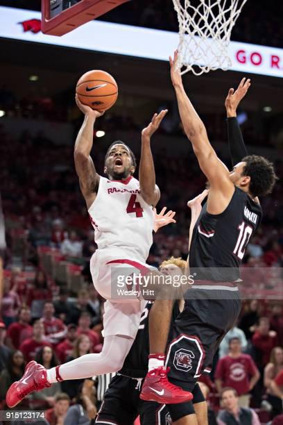 Daryl Macon of the Arkansas Razorbacks drives to the basket for a shot against Justin Minaya of the South Carolina Gamecocks at Bud Walton Arena on...